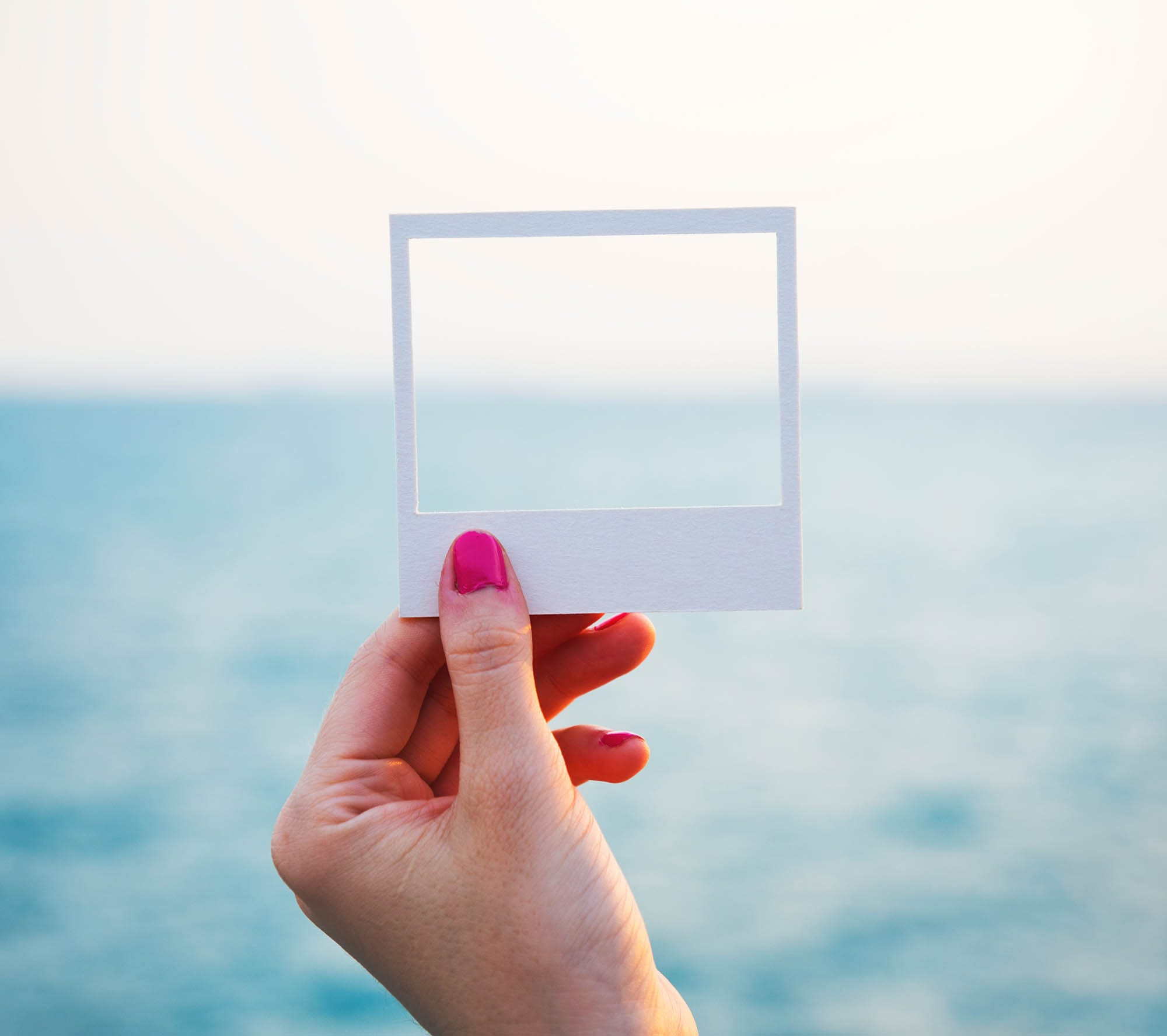 A picture frame in front of the ocean