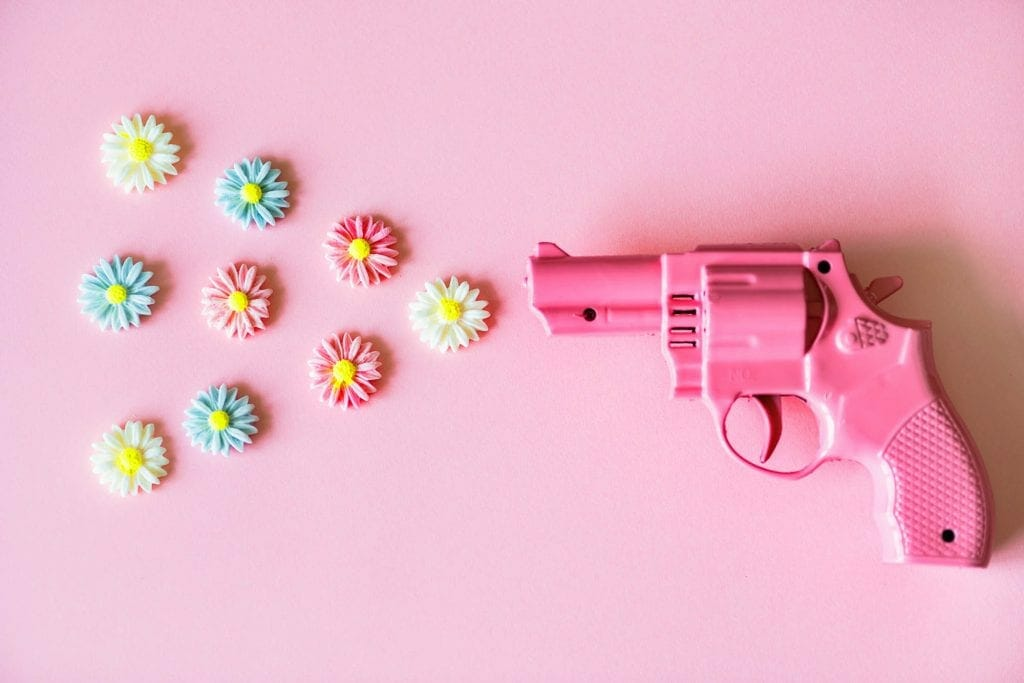 A plastic pink gun shooting out flowers